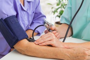 Closeup of a doctor taking patient's pulse